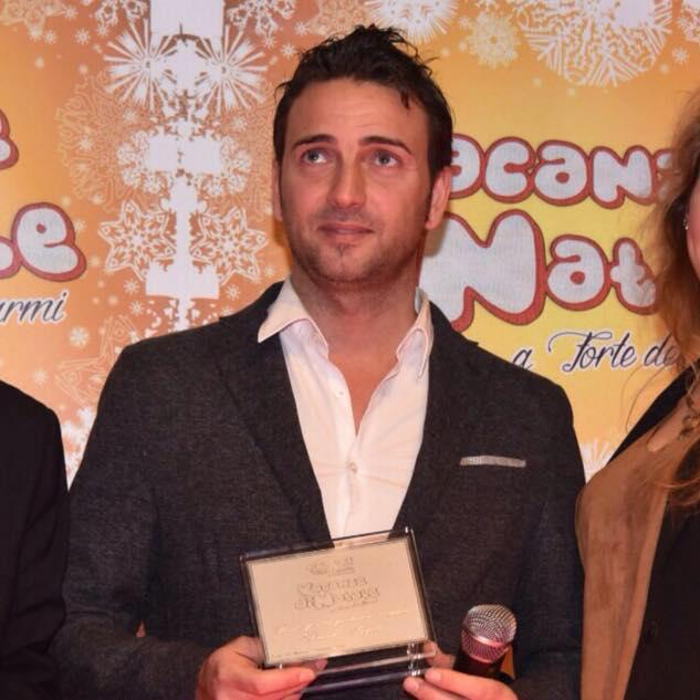 Angeli Davide viene premiato per film Vacanze di Natale - siti web la spezia - gestione social network